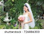 beautiful woman holding flower... | Shutterstock . vector #726886303