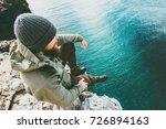 man traveler sitting on cliff...   Shutterstock . vector #726894163