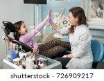 happy female dentist and girl... | Shutterstock . vector #726909217