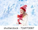 child eating candy apple on... | Shutterstock . vector #726973087