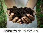 Small photo of Farmer holding pile of arable soil. Male agronomist examining quality of fertile agricultural land. Can be used as a fertilizer to accelerate the growth of plants.