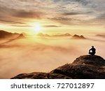 tourist sit on peak of... | Shutterstock . vector #727012897