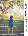 little boy stand on green chair ... | Shutterstock . vector #727023607