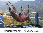 meat of a lamb on the spit... | Shutterstock . vector #727027063