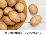 raw potato on wooden background.... | Shutterstock . vector #727096843