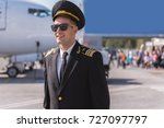 Small photo of Hilarious airman near big plane