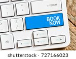 Small photo of Book now / Computer white keyboard with book now.