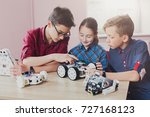 children creating robots at... | Shutterstock . vector #727168123