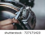 cropped image of mechanic is... | Shutterstock . vector #727171423