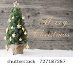 golden decorated christmas tree ... | Shutterstock . vector #727187287
