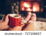 woman holding a cup of tea by... | Shutterstock . vector #727208857