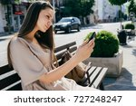 cute girl sitting on a bench on ... | Shutterstock . vector #727248247