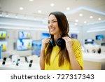 beautiful smiling girl is... | Shutterstock . vector #727317343