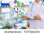 the pharmacist working pharmacy ... | Shutterstock . vector #727336333