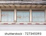 sidewalk by street wall   door | Shutterstock . vector #727345393