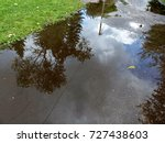 reflective big puddle on the...   Shutterstock . vector #727438603
