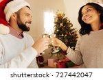 lovely couple clinking glasses... | Shutterstock . vector #727442047
