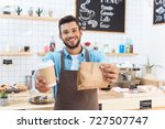 handsome smiling young barista... | Shutterstock . vector #727507747