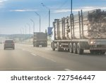 large truck with logs on the