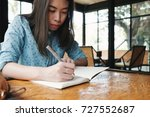 young asian woman reading book... | Shutterstock . vector #727552687