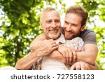 the old man on a wheelchair and ... | Shutterstock . vector #727558123