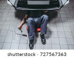 handsome mechanic in uniform is ... | Shutterstock . vector #727567363