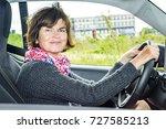 woman in car  | Shutterstock . vector #727585213