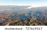 small lakes appearing on the... | Shutterstock . vector #727619317
