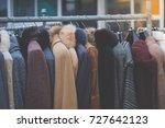 winter coats hanged on a... | Shutterstock . vector #727642123