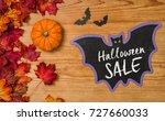autumn foliage with a pumpkin... | Shutterstock . vector #727660033