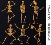dancing golden skeletons | Shutterstock .eps vector #727669417