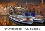 centraal damrak canal in... | Shutterstock . vector #727683553