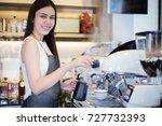 asian women barista smiling and ... | Shutterstock . vector #727732393