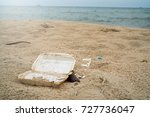 garbage on the beach. | Shutterstock . vector #727736047
