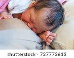 breastfeeding newborn in... | Shutterstock . vector #727773613