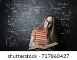 smiling young woman studying at ... | Shutterstock . vector #727860427