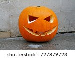 Wet Halloween Pumpkin On Gray...
