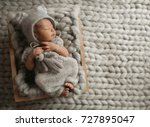 tiny baby in grey clothes... | Shutterstock . vector #727895047