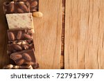 piece of chocolate with nuts on ... | Shutterstock . vector #727917997