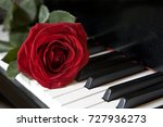 red rose on piano    Shutterstock . vector #727936273