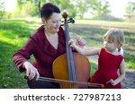 grandmother and granddaughter... | Shutterstock . vector #727987213