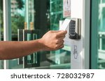 Hand Using Security Key Card...