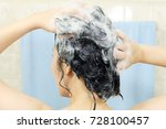 woman washing her hair. | Shutterstock . vector #728100457