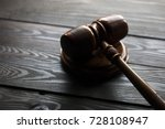 gavel on dark wooden background.... | Shutterstock . vector #728108947