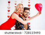 couple celebrating valentine day | Shutterstock . vector #728115493