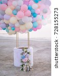 Small photo of aerostat from balloons with a basket decorated with flowers