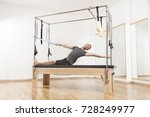 pilates instructor performing... | Shutterstock . vector #728249977