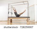 pilates instructor performing... | Shutterstock . vector #728250007