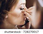 make up. bride getting on her...   Shutterstock . vector #728270017