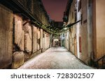 Small photo of Tallinn, Estonia. Ancient Tombstones In St. Catherine's Passage From St. Catherine's Dominican Monastery At Night. Historic Centre Old Town Of Tallinn. UNESCO World Heritage Site